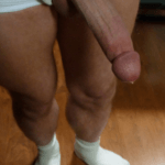 long shaved cock drips pre-cum