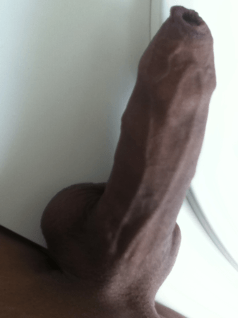 black cock hidden by foreskin